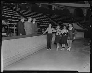Four women skating as Walter Brown and two other men look on