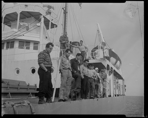 Group of 14 men stand on deck of Liberian freighter Alberta, anchored off Cape Cod canal, after Captain Gerasimos Potamianos was overpowered by the crew following his murder attempt on Elefehrios Metaxes