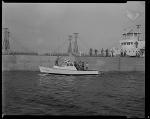 Liberian freighter Alberta with US Coast Guard boat beside it, both with men on board, anchored off Cape Cod canal, following the mutiny of the crew after Captain Gerasimos Potamianos' attempted murder of Elefehrios Metaxes