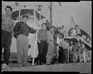 Group of 15 men stand on deck of Liberian freighter Alberta, anchored off Cape Cod canal, after Captain Gerasimos Potamianos was overpowered by the crew following his murder attempt on Elefehrios Metaxes