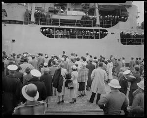 View of the crowd standing before the U.S.S. Atka