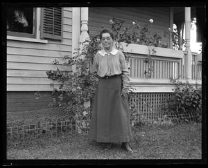 Aunt Kate, in front of house