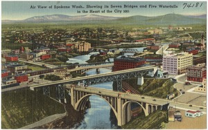 Air view of Spokane Wash., showing its seven bridges and five waterfalls in the heart of the city