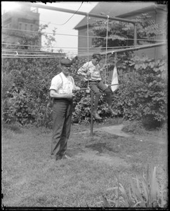 C.R. Wilhelm and son in the yard