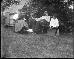 C.R. Wilhelm with his daughter and son in their backyard