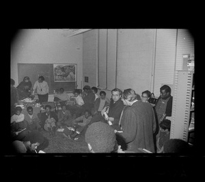 Black students at Brandeis University during protest meet in a classroom with university officials