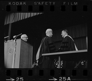 UN Ambassador Arthur J. Goldberg shakes hands with college official during Brandeis University commencement