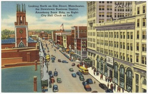 Looking north on Elm Street, Manchester, the Downtown Business District,  Amoskeag Bank Bldg. on right, City Hall Clock on left.