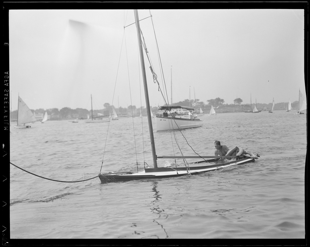 Bailing out sunken sailboat