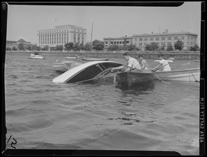 Sailing on the Charles, capsized boat