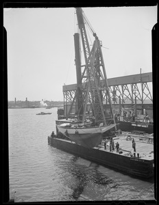 Yacht lifted by crane, Boston Harbor