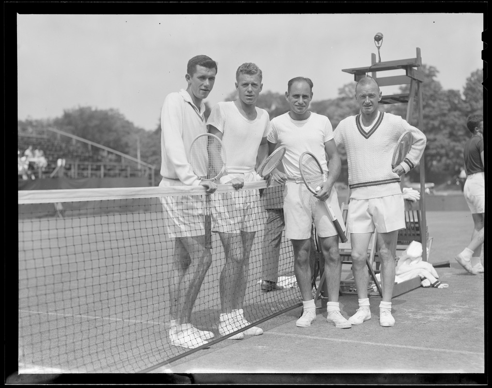 4 men with tennis rackets