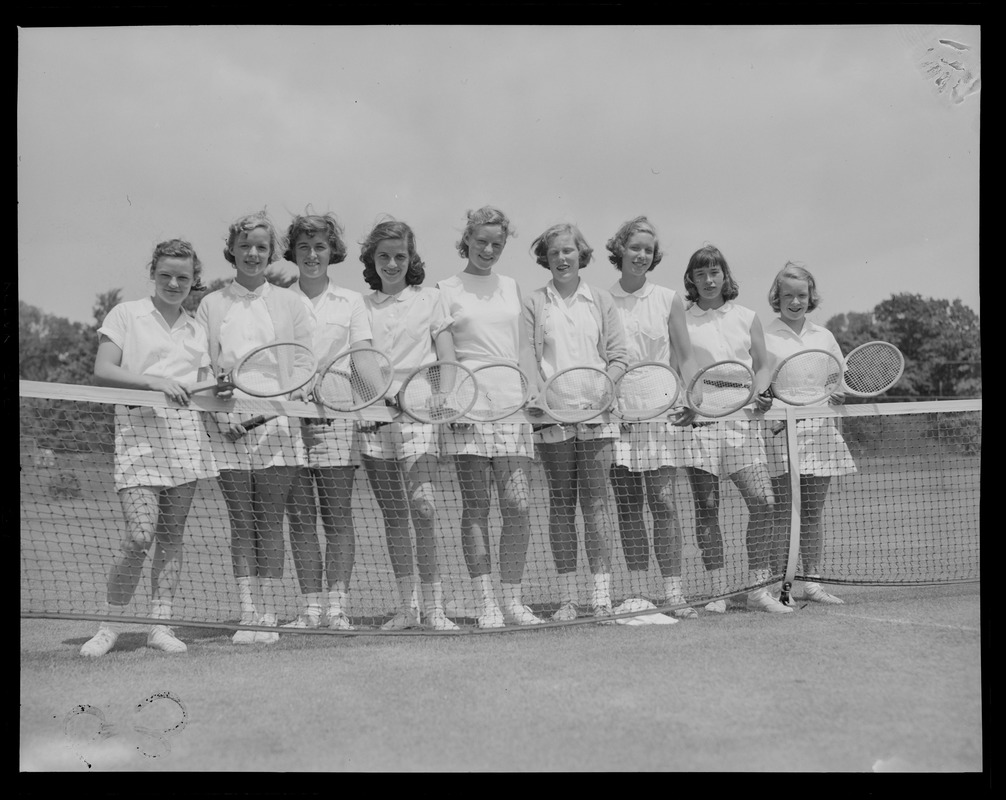 9 women with tennis rackets