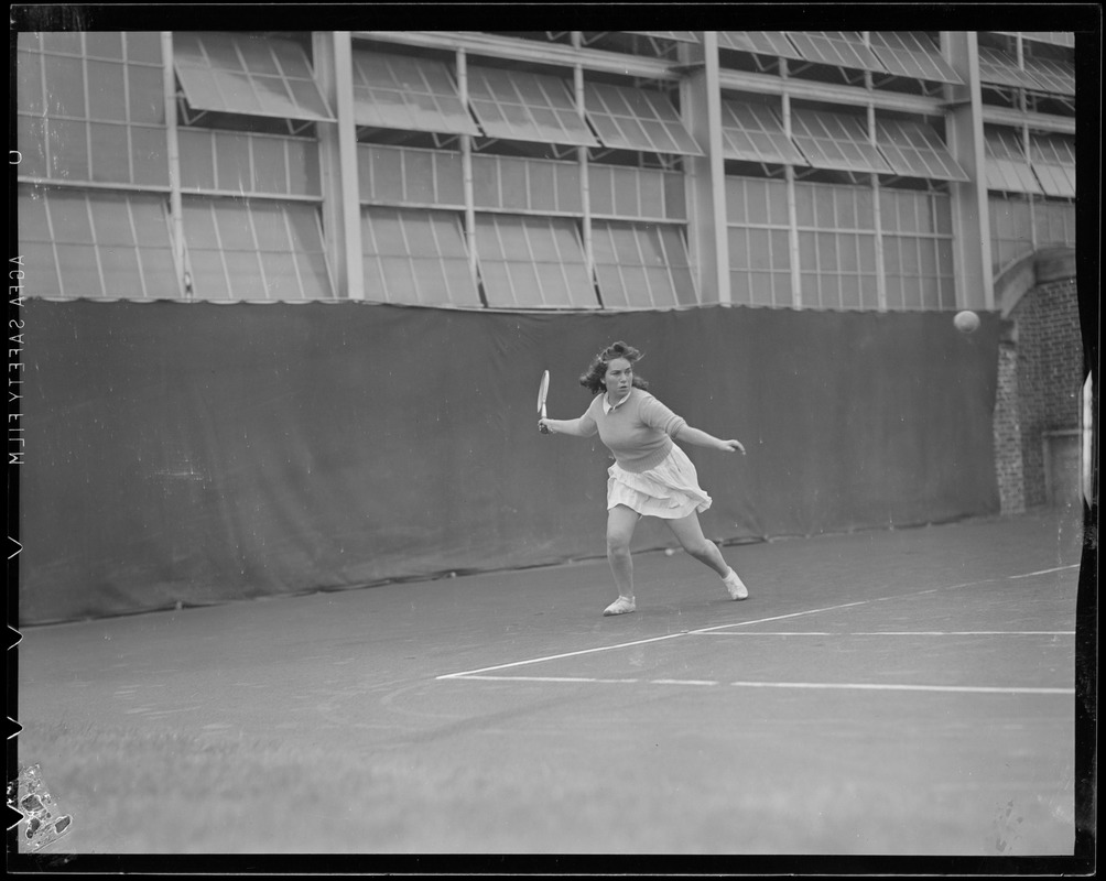Woman player in action, possibly Longwood