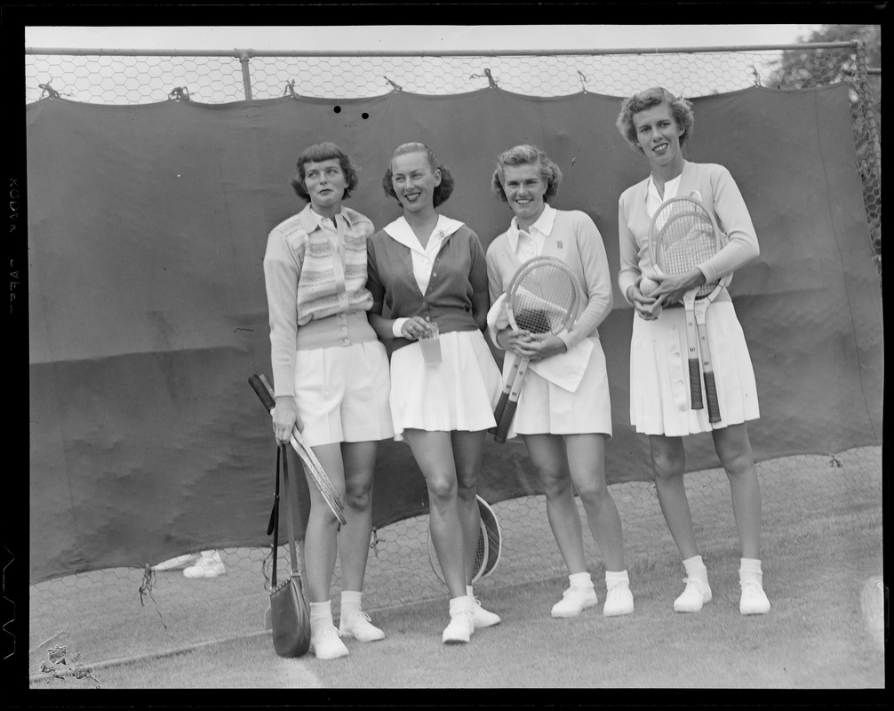 4 women with tennis rackets