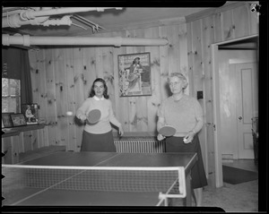 Hazel Wightman tries her hand at ping pong at her home at 17 Dorothy Rd., Newton
