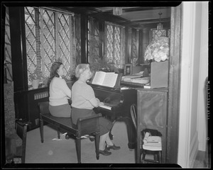 Hazel Wightman playing the piano at her home at 17 Dorothy Rd., Newton