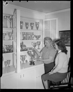 Hazel Wightman shows off her trophies at her home at 17 Dorothy Rd., Newton