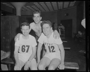 Athletes in locker room at track meet, after 1934