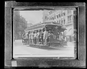 Boston elevated open trolley, fully loaded, going through Scollay Square