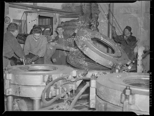 Men working on the tire for scrap, WWII
