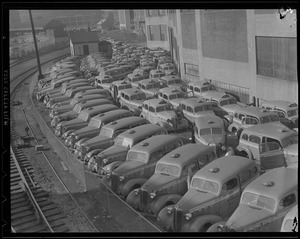 Taxis with tires removed for war effort
