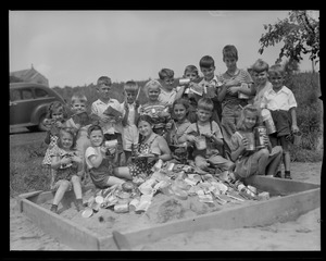 Children collecting cans for scrap