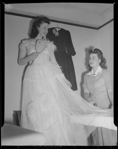 Putting on party dress, Franklin Square House, WWII