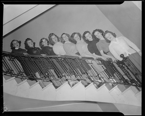 Girls pose on staircase, Franklin Square House, WWII
