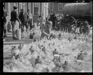 Jugs being filled with water from water cart, New England floods