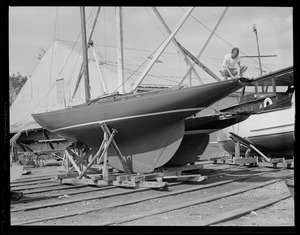 Inspecting his boat for damage after hurricane