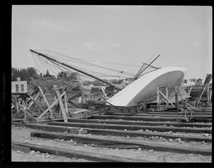 Sailboat in boat yard blown over during hurricane