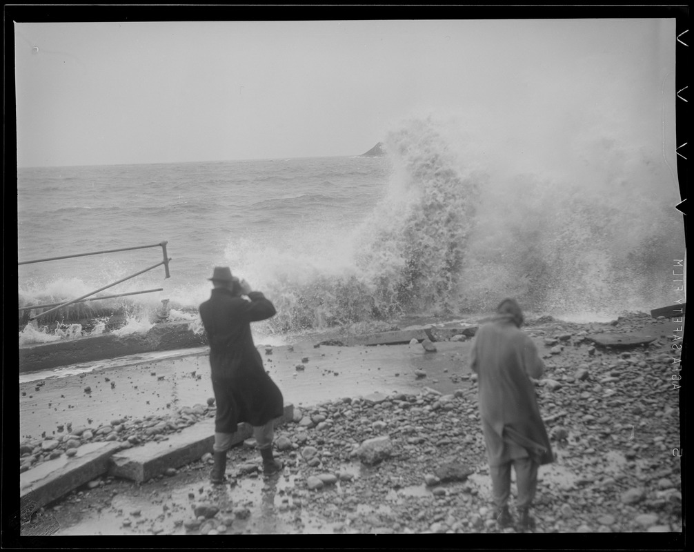 Man takes picture of surf at Beachmont, Revere
