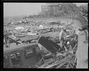 Boats beaten apart against sea wall, Hurricane of 38