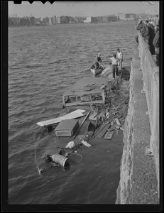 Expensive power boats smashed against granite walls in Charles River Basin, Hurricane of '38