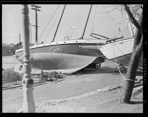 Sailboats thrown up on shore, Hurricane of 38