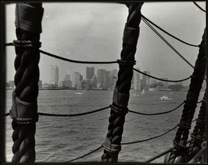 Skyline of Boston through ship's rigging