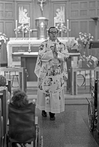 Priest conducts mass for orphan boys, Brighton