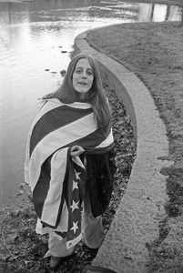 Enigmatic girl wrapped in U.S. flag, Cambridge