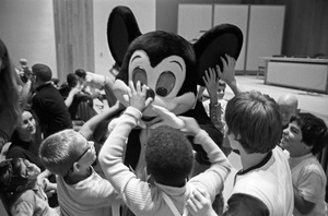 Blind children meet Mickey Mouse by touch at Perkins School for the Blind, Watertown