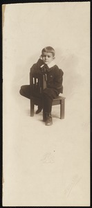 Unidentified seated boy with wide collar