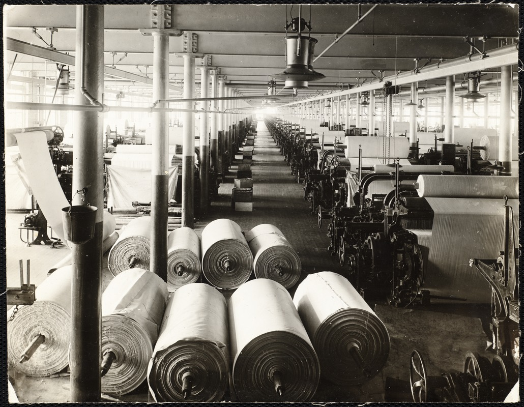 Interior mill room with fabric bolts