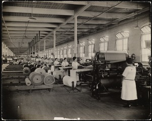 Cloth inspection at Lawrence Text. Mill