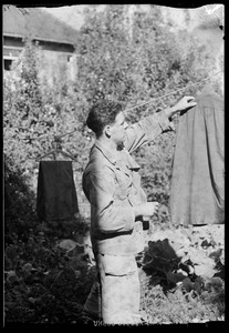 U. S. Army soldier hanging laundry, Waiblingen, Germany