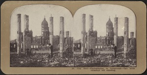 City Hall -- photographer in foreground -- tall brick chimneys left standing