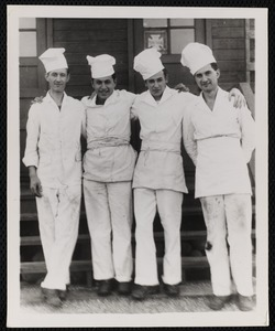 Four chefs posing together (names on back)