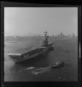 USS Wasp carrier with a landing strip nearing the Boston coastline