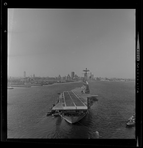 Head-on view of USS Wasp carrier with a landing strip nearing the Boston coastline