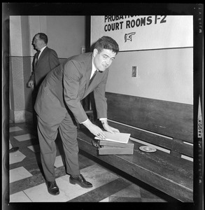 Assistant District Attorney Donald Conn with documents outside of the court room