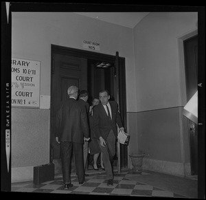Men walking in and out of Court Room No. 5